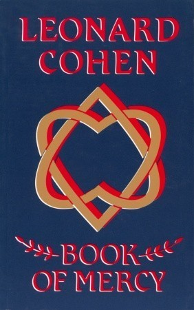 "Dark blue book cover with the words ""Leonard Cohen"" at the top in red block lettering, a design of intertwined hearts in gold outlined in red in the middle, and the tile ""Book of Mercy"" in red block lettering at the bottom."
